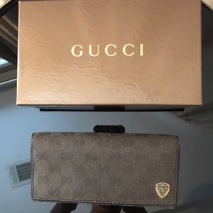 Gucci Brown fabric with gold Gucci emblem wallet